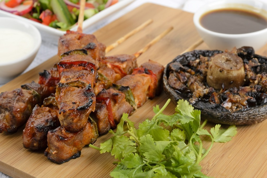 Pork kebabs with peppers. Salad, grilled mushroom & BBQ sauce